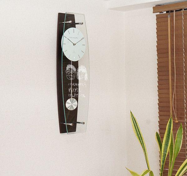 米寿祝いにお子様が描いた似顔絵時計のプレゼント